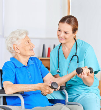 senior woman doing exercise with her caregiver