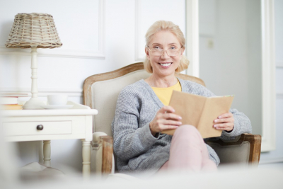 senior woman holding her book