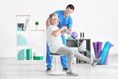 therapist helping a senior man